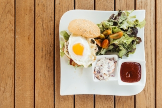 Soft focus point on hamburger with vegetable - Vintage Filter